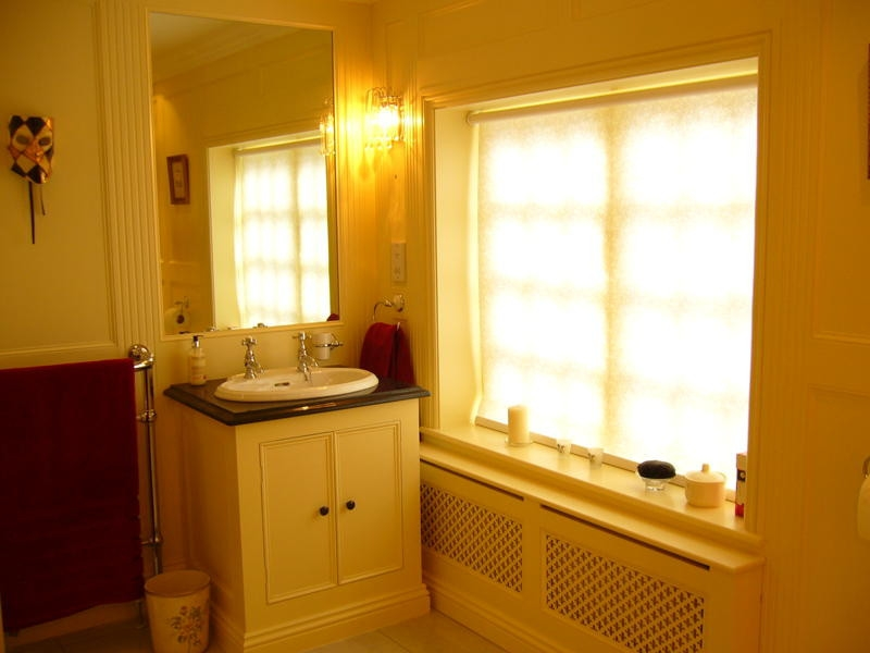 Full Height Paneled Bathroom Showing Vanity Unit And Radiator Cover